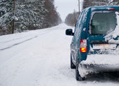 Snowy winter road and cargo car — Stock Photo