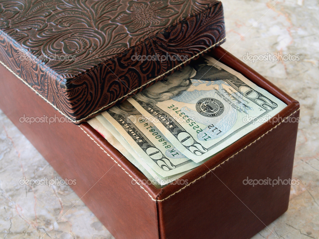 Brown leather box with us dollars on the table — Stock Photo #4085396