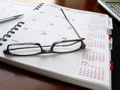 Monthly planner with glasses — Stock Photo