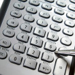 Silver calculator and pen — Stock Photo