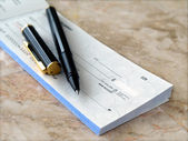 Cheque with pen. — Stock Photo