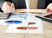 Businessman with charts. — Stock Photo