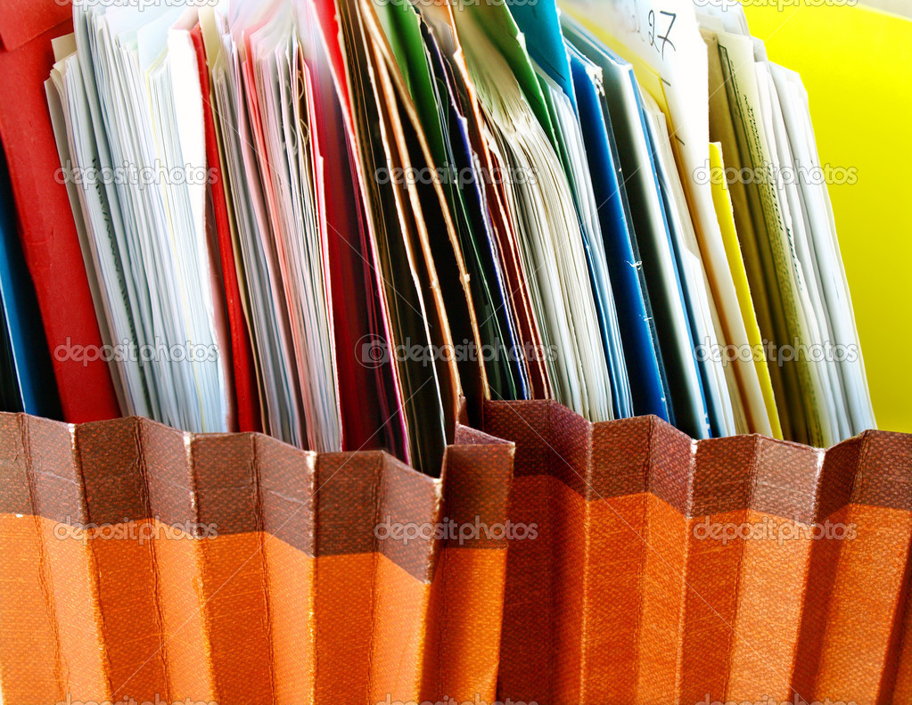 Row of folders in expending file pockets — Stock Photo #5125686