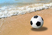 Football in the sand at the beach — Stock Photo