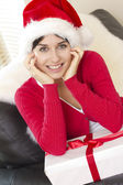 Picture of cheerful girl with gift box — Stock Photo