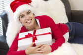 Sexy girl holding a gift in packing — Stock Photo