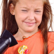 Girl with developing hair and hairdryer — Stock Photo
