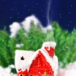 Christmas card with a house in the woods and snowing — Stock Photo