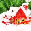 Stock Photo: Christmas card with SantClaus gifts on background snowy forest