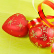 Two Christmas balls on a green background — Stock Photo