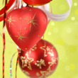 Christmas balls on a green background and abstract bokeh with s — Stock Photo