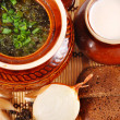 Rustic food, soup in a clay pot — Stock Photo