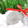 Silver ball with a New Year's gifts to the background of the for — Stock Photo