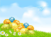 Vector Easter eggs on a green field with daisies and a blue sky — Stock Vector
