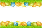 Marco de vector de huevos de pascua y hierba verde — Vector de stock