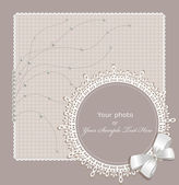 Vector lace picture frame on a beige background — Stock Vector