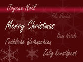 Xmas card multiple languages - red — Stok fotoğraf