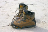 Hiking boots on the sand — Stok fotoğraf