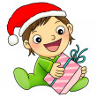 Boy with Christmas present — Stock Photo #4057264