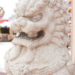 Stock Photo: Lion carved from stone.