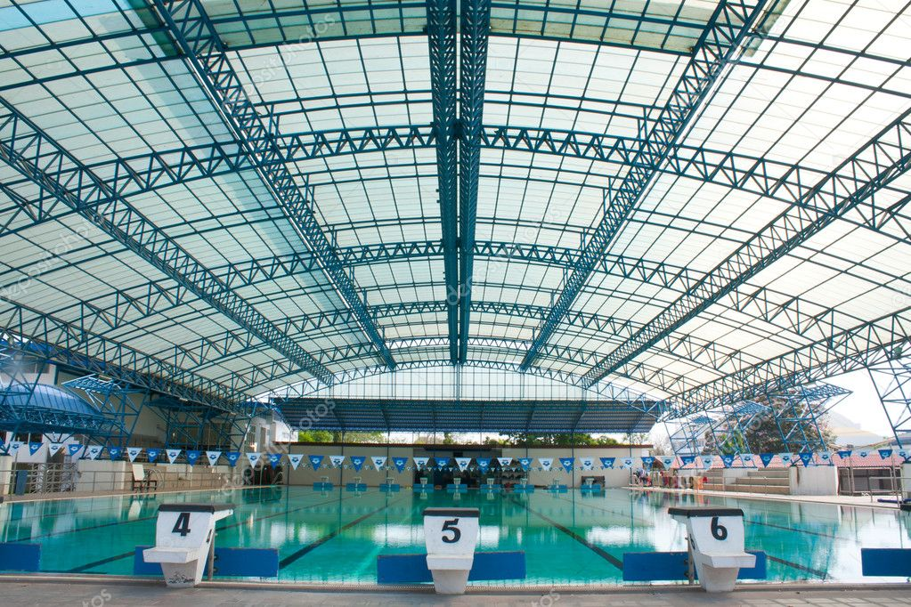 Stadium, swimming pool as the next track, swimming. — Stock Photo #5228809