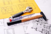 Tools on house plans including hammer, screw driver and monkey wrench — Stok fotoğraf