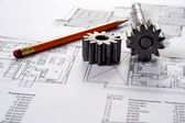 Tools on Blueprints including sprocked stacks and pencil — Stock Photo