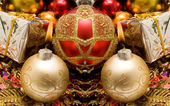Colorful decorative Christmas candle and ornaments — Stock Photo