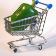 Shopping cart with green pepper — Stok fotoğraf
