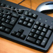 Mouse,glasses and keyboard — Stok fotoğraf