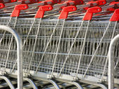 Shopping metallic cart — Stock Photo