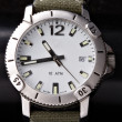 Steel sport watches with khaki wrist — ストック写真