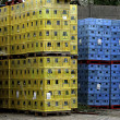 Pallets of boxes yellow and blue (Coloured crates ) — Stock Photo #5269470