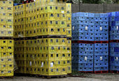 Pallets of boxes yellow and blue (Coloured crates ) — Stock Photo
