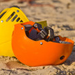 Two colourful helmets in the sand — Stock Photo