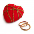 Wedding rings with red velvet heart — Stock Photo