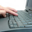 Hand on keyboard — Stock Photo