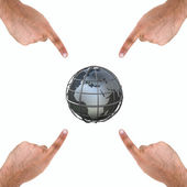 Four hands pointing to earth — Stock Photo