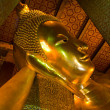 Reclining buddha within the Wat Pho in Bangkok Thailand — Foto Stock