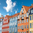 Colorful Danish houses near famous Nyhavn canal in Copenhagen, Denmark - Stock Photo