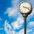 Clock against the sky — Stockfoto