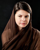 Woman wearing scarf on black — Stock Photo