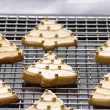 Royalty-Free Stock Photo: Decorated christmas cookies on the backing tray