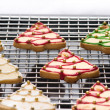 Decorated christmas cookies on the backing tray — Stock Photo