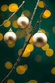 Christmas decoration in front of lights — Stock Photo