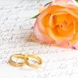 Rose, rings over handwritten letter — Stock Photo #4548256