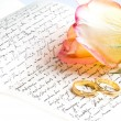 图库照片: Red yellow rose, ring over hand written letter