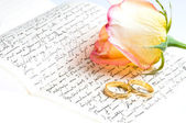 Red yellow rose, ring over a hand written letter — Stock Photo
