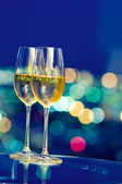 Champaign glasses in front of a window — Stock Photo