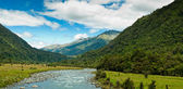 River flowing through a valley on a summer day — Stock Photo